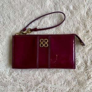 COACH Plum wallet and wristlet